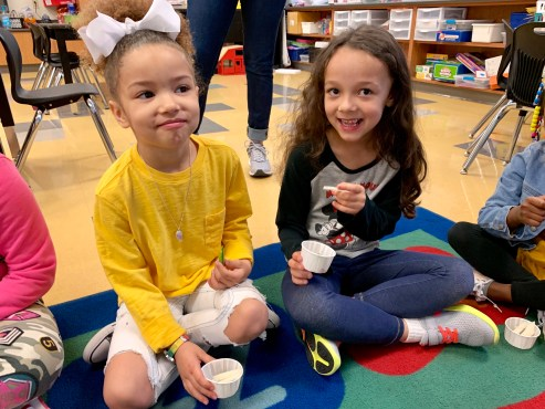 Girls taste jicama radishes_Action for Healthy Kids