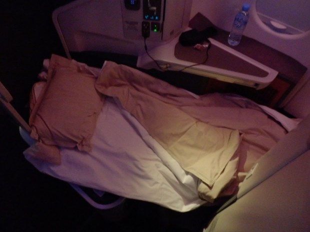 BUSINESS CLASS SEAT IN FLAT-BED POSITION