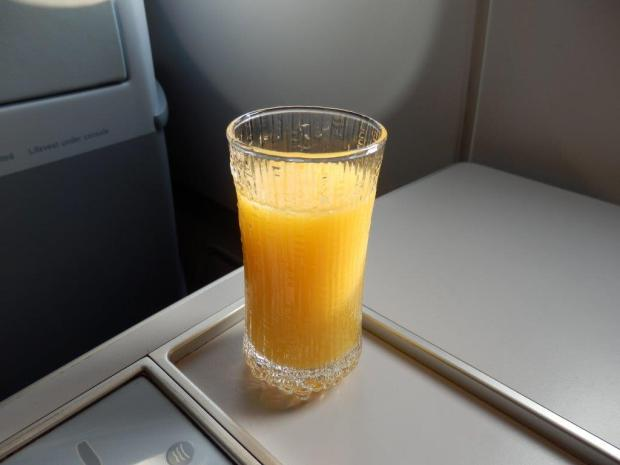 FRESH ORANGE JUICE SERVED BEFORE TAKEOFF