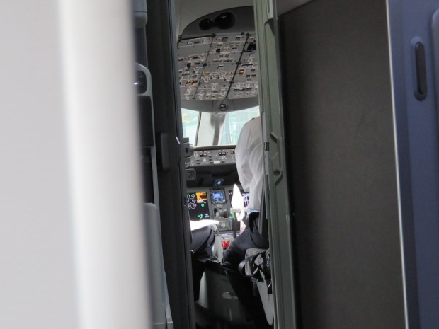 FIRST CLASS CABIN: VIEW INTO THE COCKPIT