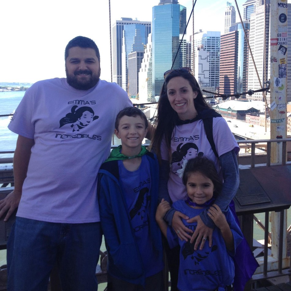 Emma and her family pose together on the Brooklyn Bridge.