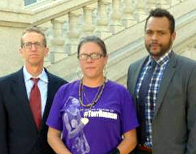 Robinson's mother, Andrea Irwin, with attorneys David Owens, right, and Jon Loevy. Gilman Halsted/WPR.