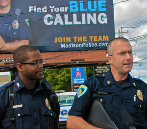 Officer Tyrone Williams with Sgt. Tim Patton at the unveiling of MPD's new local recruitment billboard. Photo by Brianna Rae