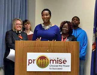 From left to right: DWD Deputy Secretary Georgia Maxwell, CEO Employment Consultant Stephanie Bostedt, President at Our Next Generation, Inc., La Toya Sykes, Wisconsin Promise participant Diane Cook, and her son Derek.