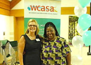 Pennie Meyers, executive director of WCASA, with Loretta Ross, keynote speaker and human rights activist, at WCASA's Celebration for Peace, Prevention, and Healing. Photo by Veronika Slavova.