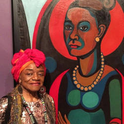 """Faith Ringgold standing with her """"Early Works #25: Self-Portrait,"""" 1965, at the Brooklyn Museum. Photo by Robin Cembalest."""