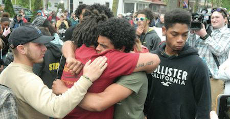 Protesters mourn Tony Robinson during a protest last May. Photo by Steven Potter.