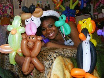 Amber, a balloon artist and graduate of the Network For Teaching Entrepreneurship. Photo courtesy of Urban News Service.