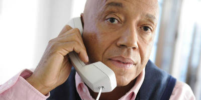 russell-simmons-making-phone-call