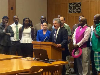Madison Mayor Paul Soglin is joined by members of the Focused Interruption Committee to announce a proposal to reduce violence in the city. Bridgit Bowden/WPR