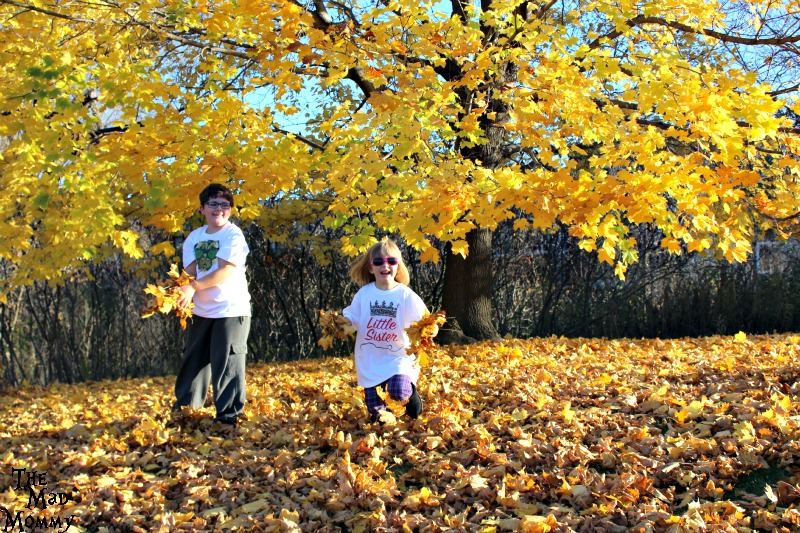 Throwing leaves in their apericots t-shirts!