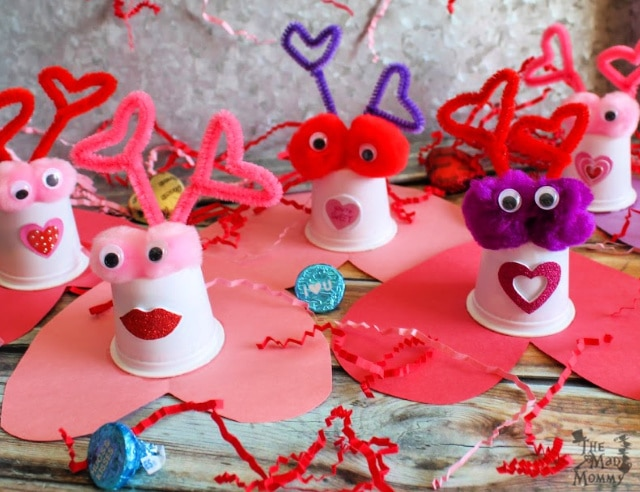 A perfect little K-Cup craft that ends with an adorable K-Cup Valentine filled with treats! On Valentine's Day, let your Valentine pull off the heart and enjoy the candy inside of these K-Cup Valentine Candy Critters!