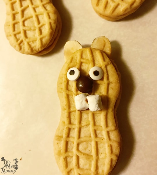 Turning Nutter Butter cookies into cute groundhogs for Groundhog Day!