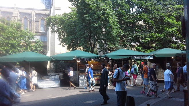 Lunch stalls at Borough market, with Southwark cathedral in the background