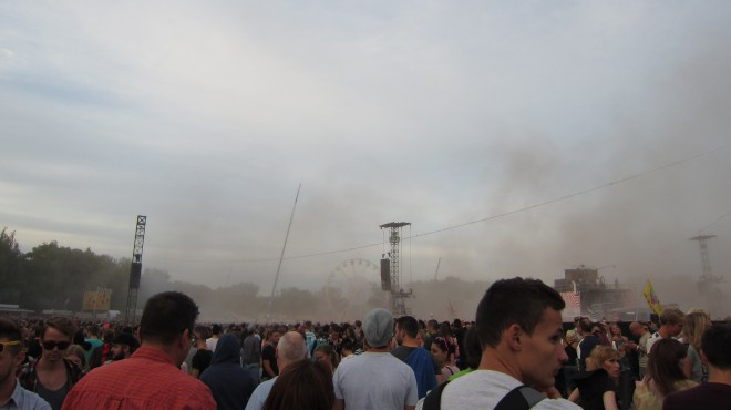 paint dropped, Holi festival style, onto crowds around the main stage