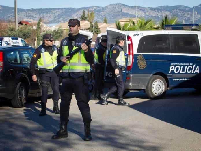 Armed cops will be a common sight in Spanish resorts this summer
