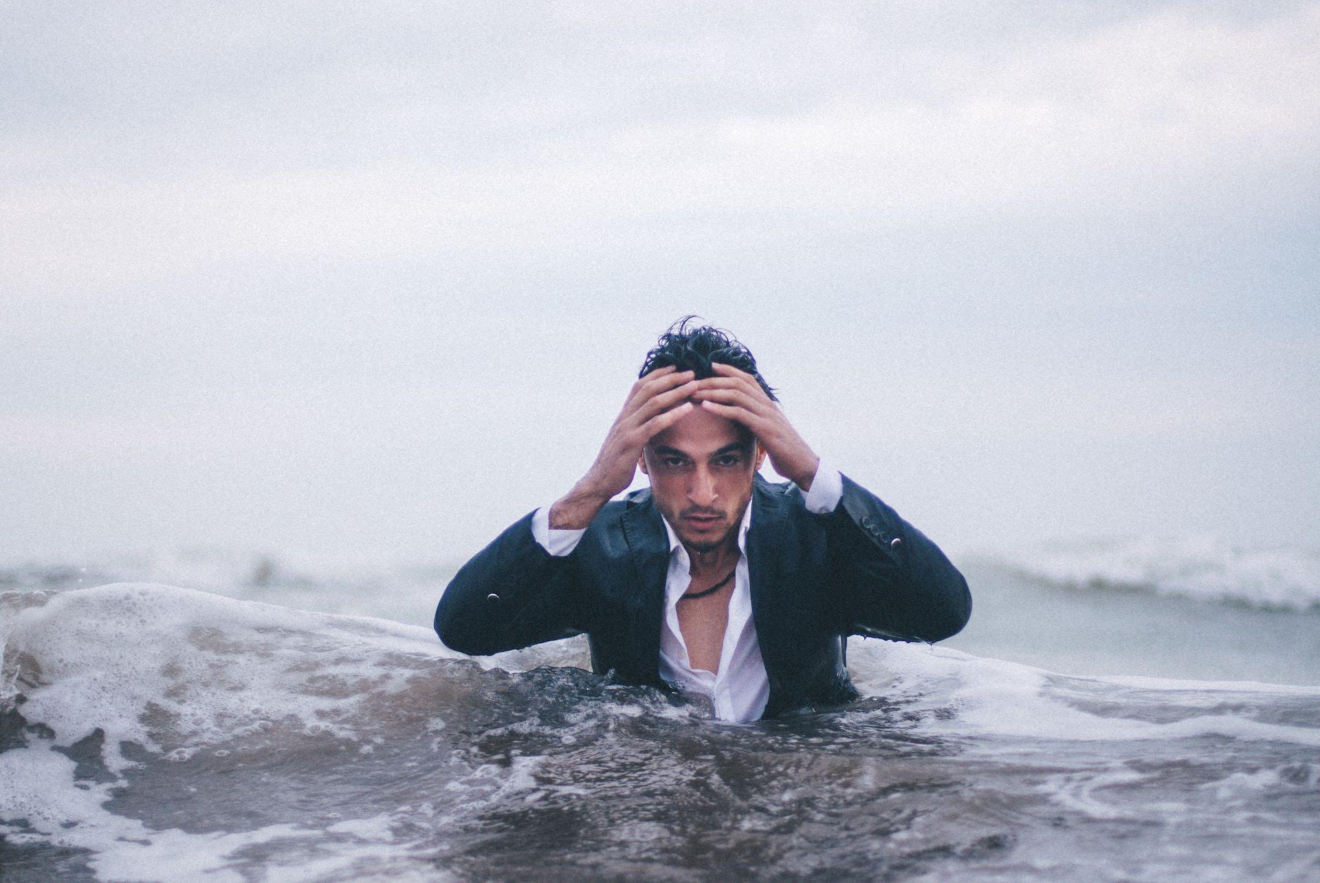 man in deep water image