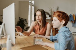 family sitting at a computer