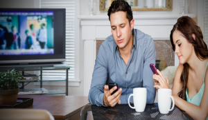 Couple sort of watch TV together