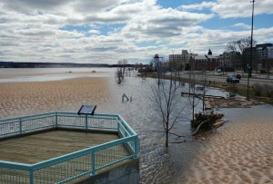 Remnants of ice-melting sand on Saint Anne's Point Drive create breathtaking sandbars during flood