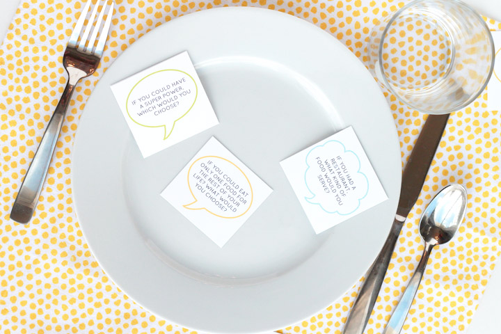 Family conversation starters on plate at dinner table