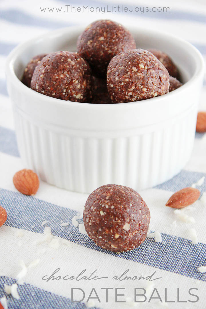 """These sneaky little chocolate almond date balls are a delicious healthy snack disguised as dessert. They have absolutely NO added sugar, so you can feel good about saying yes when your kids ask for """"just one more."""""""