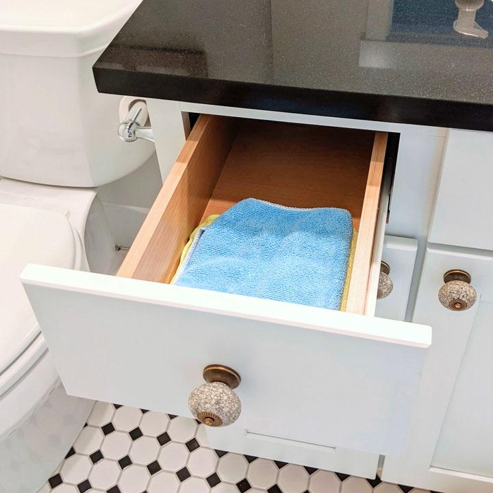 microfiber cleaning cloths in bathroom drawer