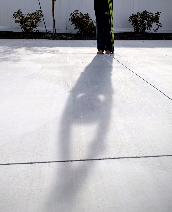 Boy's shadow on cement