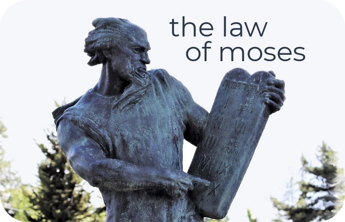 statue of Moses holding stone tablets