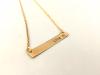 Love stamped brass bar necklace