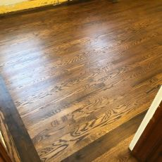 """Aacer red oak with 5"""" walnut border finished with Bona Craft Oil in a Cedar Rapids home. <br /> <small>Photographer: Freunds Hardwood Floors </small><small>Location: Cedar Rapids, IO </small><small>Business: Freunds Hardwood Floors </small><br />"""