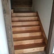 """Installed 5"""" #2 red oak flooring in hunting cabin by olsburg, kansas. Also installed skirt boards, landings, treads and risers."""