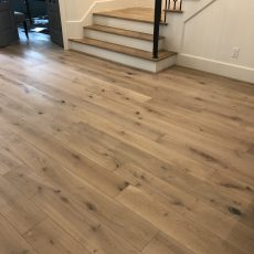 Palladio Barley flooring used throughout the entire home except upstairs secondary bedrooms. Beautiful herringbone insert in entry way to top it off. <br /> <small>Photographer: Shireen Wise </small>