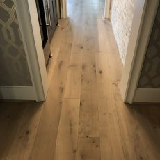 Palladio Barley flooring used throughout the entire home except for upstairs secondary bedrooms. Beautiful herringbone insert in the entryway to top it off. <br /> <small>Photographer: Shireen Wise </small>
