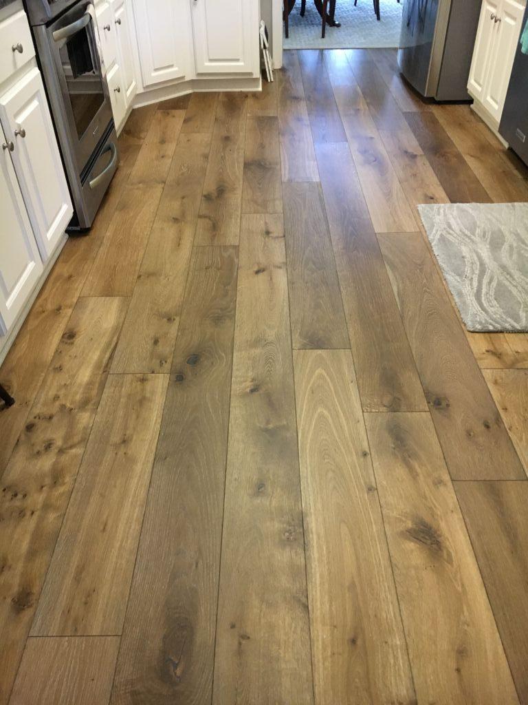 Close-up of wide plank European White Oak Palladio floor installed in kitchen