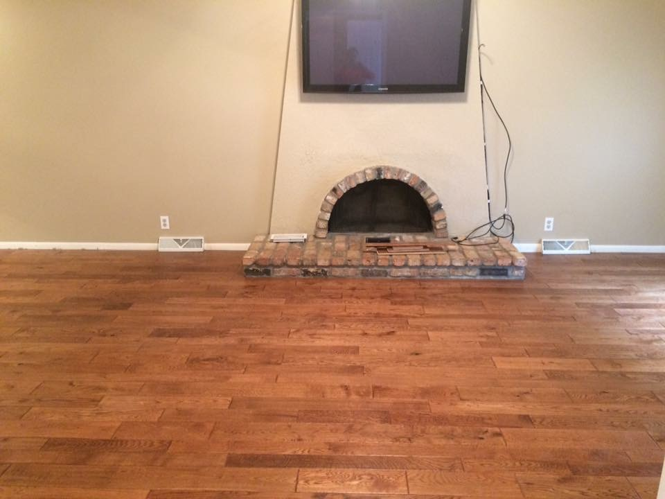 dark prefinished hardwood floor in living room