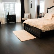 """Teckton unfinished engineered 6"""" white oak natural with a custom dark stain and satin finish in an Atlanta home."""