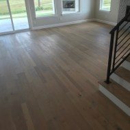 New model home with Longhouse Mödling in open great room, entry and kitchen.