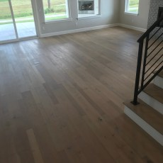 New model home with Longhouse Mödling in open great room, entry and kitchen.  <br /> <small>Location: Norman, OK </small><small>Business:  Stonewall Homes  </small><br />