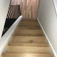 """Brick & Board Portico installed in Houston. 5"""" x 1/2"""" Engineered Hickory from Real Wood Floors."""