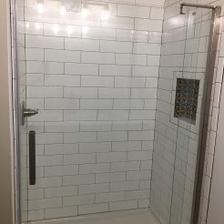 Subway-styled tile shower