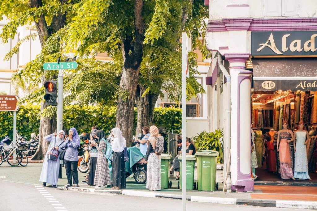 girl waving Arab street Singapore