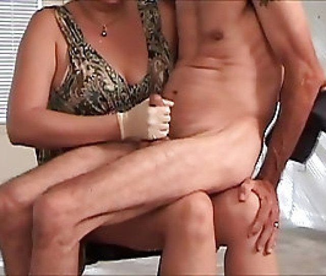 Mature Woman Jerks Off A Boy Sitting On Her Lap