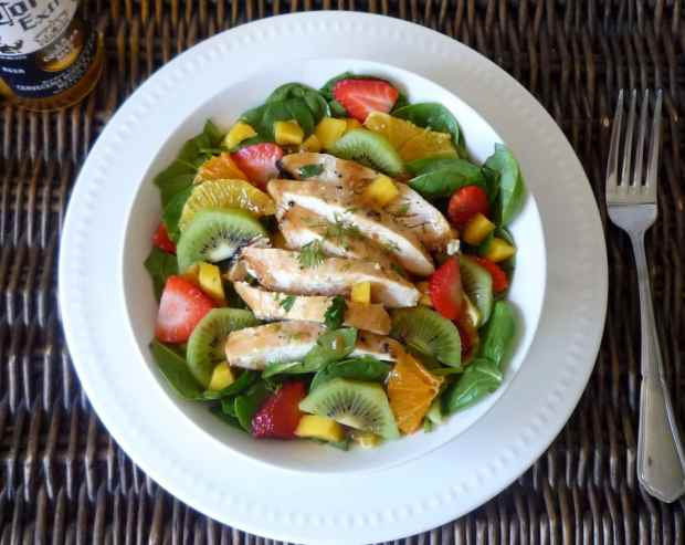 This wonderful Healthy Grilled Chicken Salad with Asian Ginger Dressing is not only healthy and bright — It has a Tropical Vibe guaranteed to bring you out of your Grilled Chicken Rut – It combines Asian Dressing on top of Healthy tender baby spinach, has beautiful color and a delish Tropical flavor with the addition of citrus, mangoes, strawberries, and kiwi.