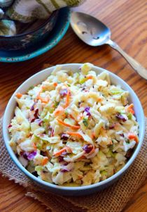 Apple-Cabbage Coleslaw is one of those deliciously refreshing packed with flavor side dishes, that will compliment most of your grilled menu items; such as chicken, fish, or even pork. Made with crisp green cabbage, purple cabbage, crunchy carrots, green apples, red delicious apples, sweet red bell peppers, celery, onion, dried cranberries, and homemade creamy dressing to bring it all together.