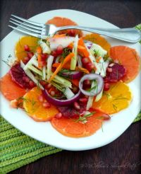 Fennel Citrus & Pomegranate Salad is the perfect winter Fruit & vegetable salad of the season combining Florida's delicious fresh ripe jewels of Ruby Red Grapefruit, Navel Oranges, and stunning Blood oranges with the crisp, clean taste of Fennel, shaved celery, Carrots and gorgeous Pomegranate seeds lightly dressed in Olive oil and Balsamic - Pomegranate vinaigrette. My recipe for  Fennel Citrus & Pomegranate Salad is so delicious and straightforward; it's almost deliriously ridiculous.