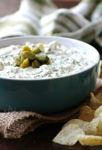 Homemade Dill Pickle & Garlic Chip Dip is one of the quintessential snack recipes combining cream cheese, sour cream, dill pickles, spring onions, fresh minced garlic, fresh dill weed, a dash of Tabasco, and kosher salt, and freshly ground pepper. This awesome Dill Pickle lovers dip is perfect for old-fashioned kettle chips or any chip you love to dip.