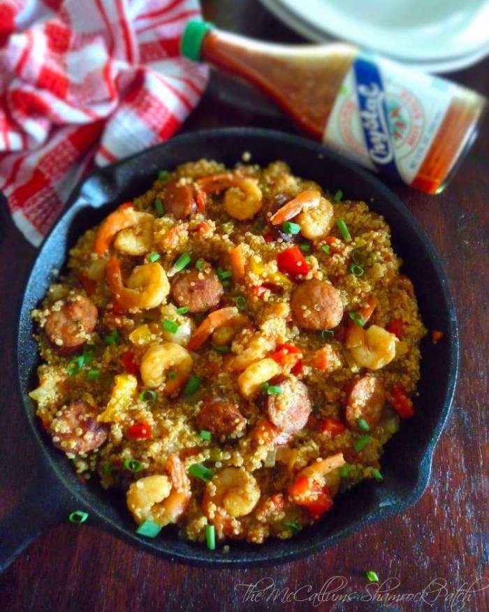 Jambalaya with White Quinoa combines a delightfully slightly spicy andouille sausage, Gulf shrimp, onions, green bell peppers, sweet red bell peppers, celery, tomatoes, chicken stock, and Cajun spices