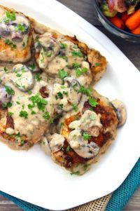 Braised Chicken & Cremini Mushrooms in Bourbon Sauce is fabulous rustic comfort food to serve to family and friends. It's a delicious combination of decadent creamy bourbon sauce over braised chicken with cremini mushrooms that you won't soon forget.