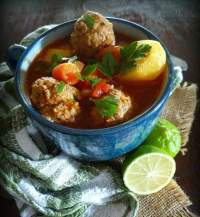 This fabulous soup centers around the famous Mexican Albondigas or Meatballs made with lean ground beef, rice, minced onions, garden fresh parsley, mint, oregano, and cumin, served in a warm broth with seasonal veggies
